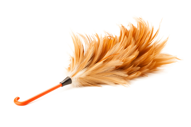 Soft duster with plastic handle on white background
